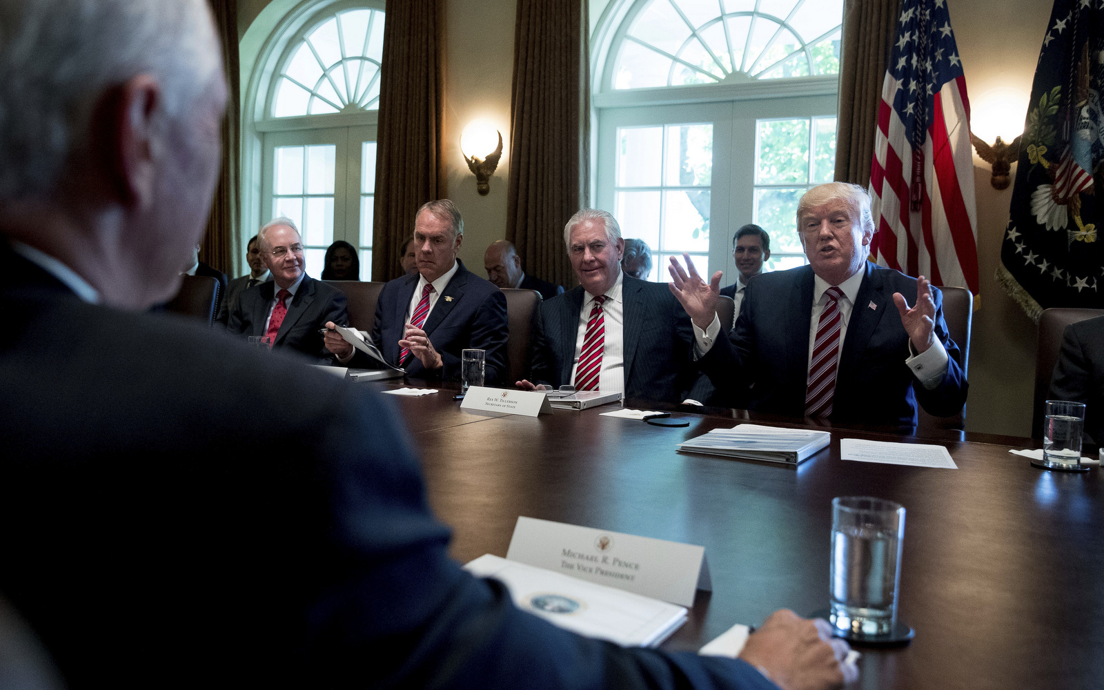 Flanked by former Exxon executive, now Secretary of State Rex Tillerson, President Donald Trump speaks during a cabinet meeting., June 12, 2017. (AP/Andrew Harnik)