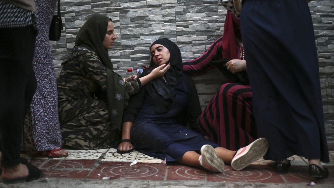 A protester is helped during a demonstration in the northern town of El Hoceima, Morocco, July 20, 2017. Clashes between police and Moroccan protesters Thursday left at least 83 injured in clouds of tear gas and running battles at an unauthorized demonstration over inequality and corruption. (AP/Therese Di Campo)