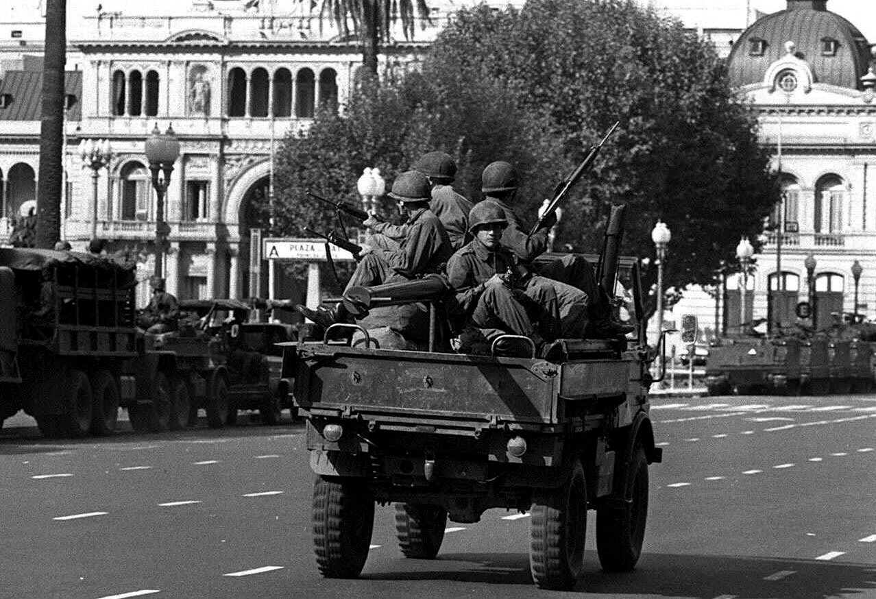 Army soldiers patrol the Buenos Aires Plaza de Mayo on March 24, 1976 after a military coup led by Gen. Jorge Rafael Videla overthrew President Isabel Peron. (AP/Eduardo Di Baia)