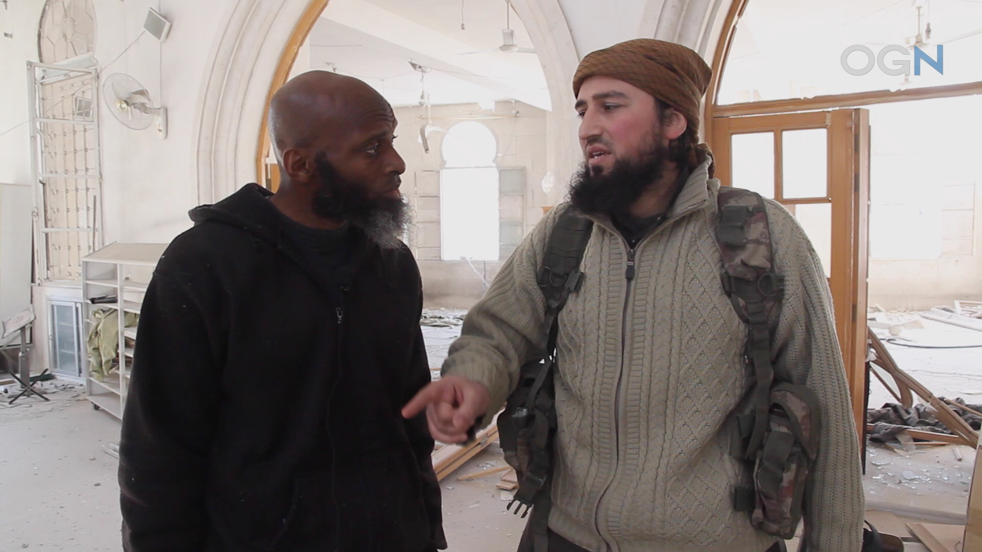 Bilal Abdul Kareem with the leader of Syrian rebel forces in Aleppo.