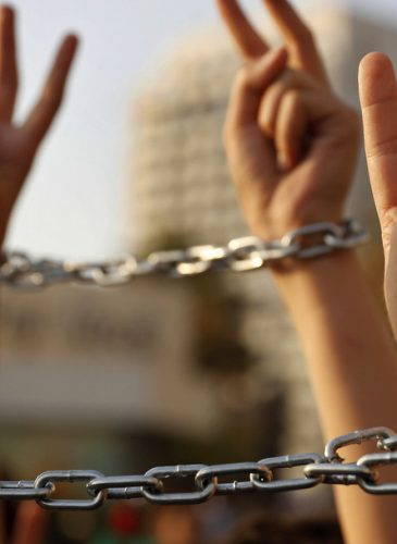 Palestinian boys raise up their hands with chains, during a protest to show their solidarity with hunger striking Palestinian prisoners in Israeli jails, who have been on an open-ended hunger strike for the past 18 days, in Beirut, Lebanon, Thursday, May 4, 2017. (AP Photo/Hussein Malla)