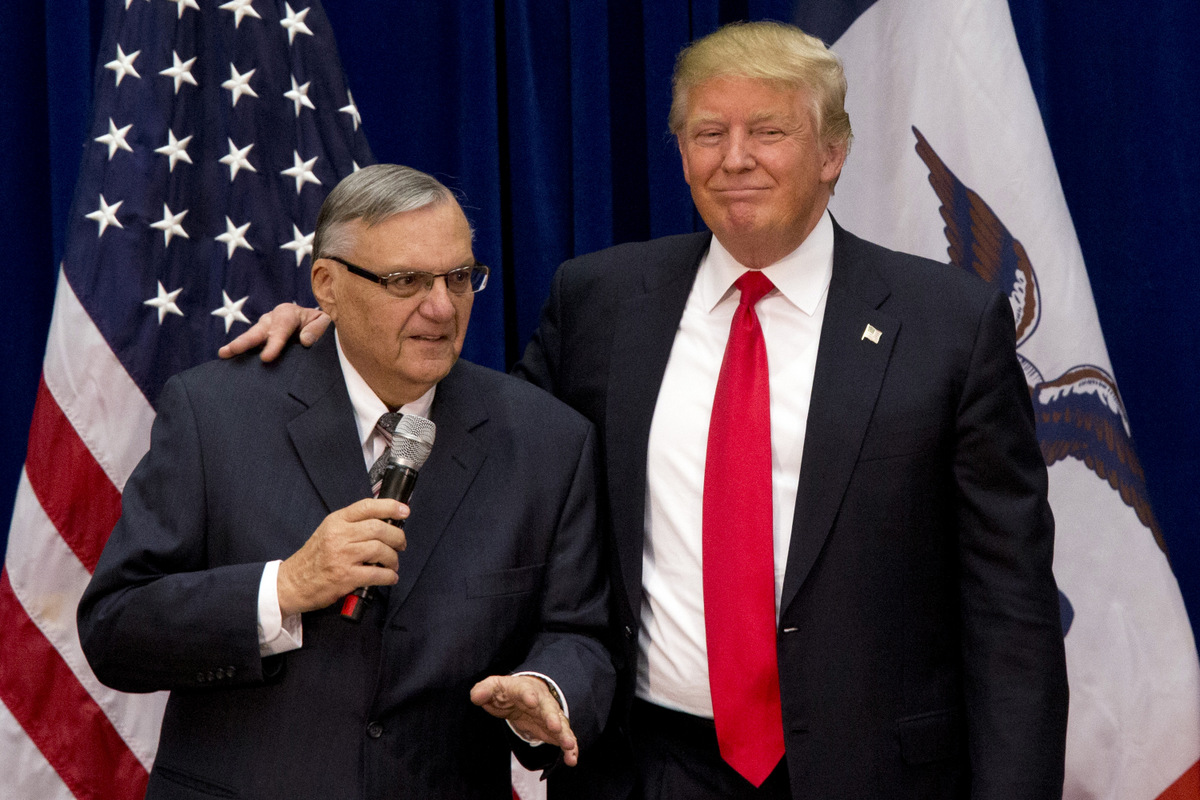 Then presidential candidate, Donald Trump, is joined by Maricopa County, Ariz., Sheriff Joe Arpaio at a campaign event in Marshalltown, Iowa. (AP/Mary Altaffer)