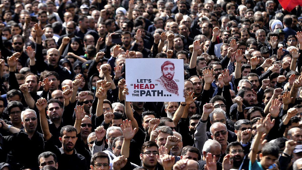 Thousands of Iranians attend the state funeral of Mohsen Hojaji, a young Revolutionary Guard soldier beheaded by ISIS in Syria, in Tehran, Iran, Wednesday, Sept. 27, 2017. The death of 25-year-old Mohsen Hojaji has struck a nerve in Iran, which has suffered casualties while its troops are deployed into Iraq fighting ISIS and in Syria. (AP/Ebrahim Noroozi)