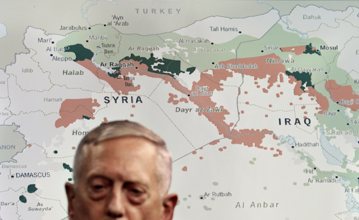 Secretary of Defense Jim Mattis stands in front of a map of Syria and Iraq ISIS, during an update to the media, Friday, May 19, 2017, at the Pentagon. (AP/Jacquelyn Martin)