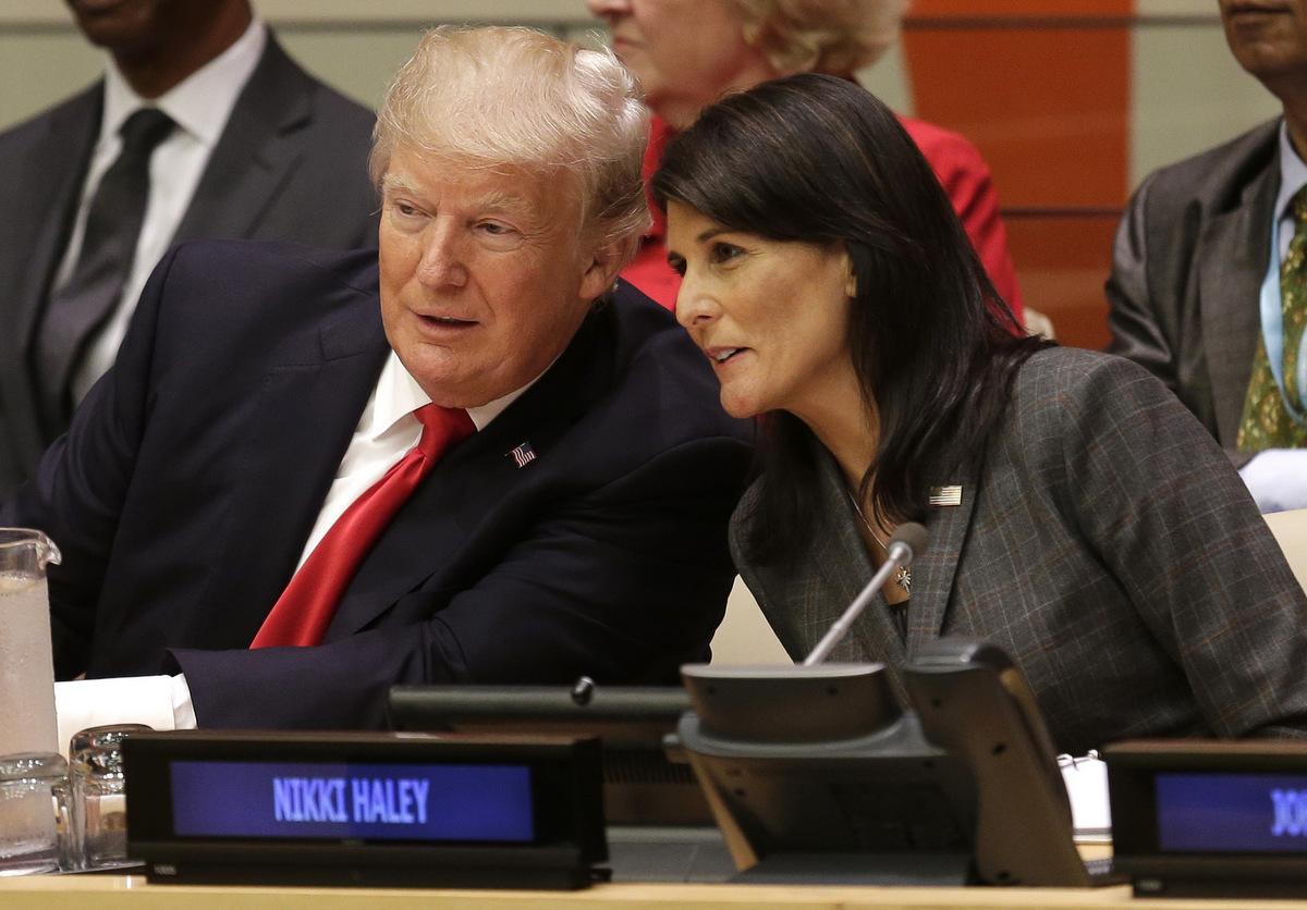 United States President Donald Trump speaks with U.S. Ambassador to the United Nations Nikki Haley before a meeting during the United Nations General Assembly at U.N. headquarters, Monday, Sept. 18, 2017. (AP/Seth Wenig)