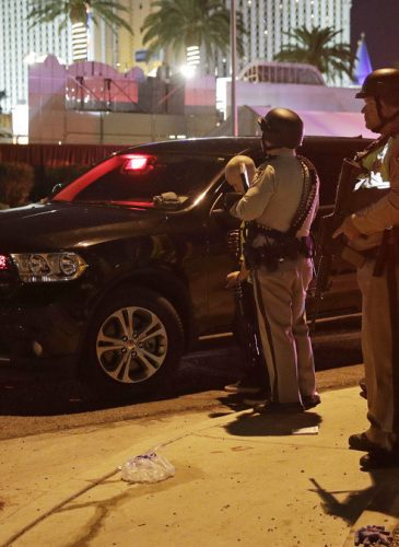 Police stand at the scene of a shooting along the Las Vegas Strip, Monday, Oct. 2, 2017, in Las Vegas. Multiple victims were being transported to hospitals after a shooting late Sunday at a music festival on the Las Vegas Strip. (AP/John Locher)