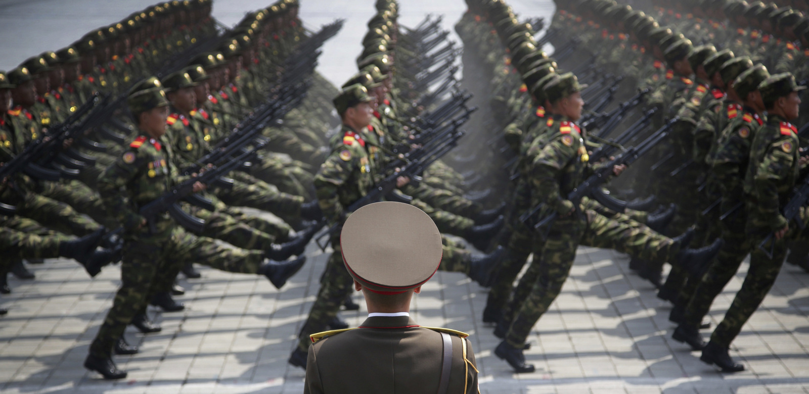 In this April 15, 2017, photo, soldiers goose-step across Kim Il Sung Square in Pyongyang, North Korea, during a parade to celebrate the 105th birth anniversary of Kim Il Sung, the country's late founder and grandfather of current ruler Kim Jong Un. The message of the parade is clear: North Korea is, or is near to being, able to launch a pre-emptive strike against a regional target. It is preparing to withstand a retaliatory follow-up attack if it does, and it is building the arsenal it needs to then launch a second wave of strikes, this time at the U.S. mainland. (AP Photo/Wong Maye-E, File)