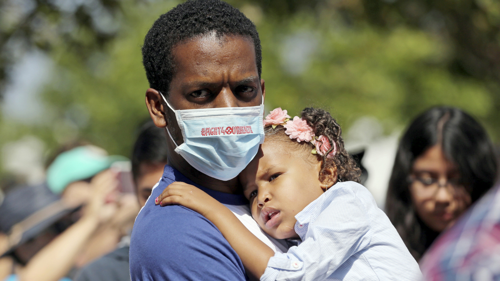 Anthony Reese, who says he is homeless, holds his daughter Makailei Pratt, 3, at a rally led by U.S. Sen. Kamala Harris, D-Calif., with doctors, nurses, health care workers and patients who will lose access to health care or see costs rise, at Harbor-UCLA Medical Center in Torrance, Calif., July 3, 2017. (AP/Reed Saxon)