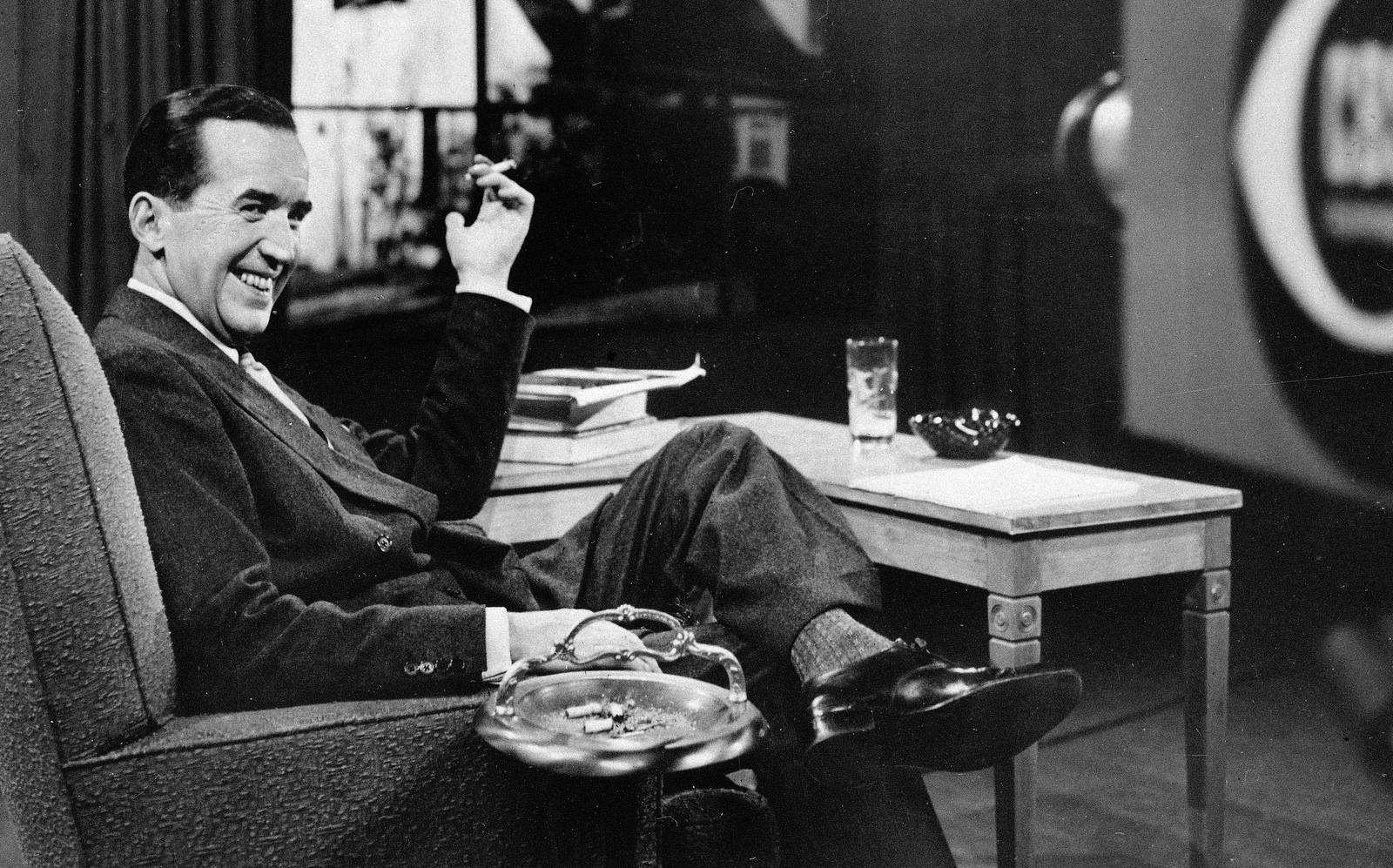 CBS News broadcaster Edward R. Murrow smokes a cigarette on a CBS set. (AP Photo)