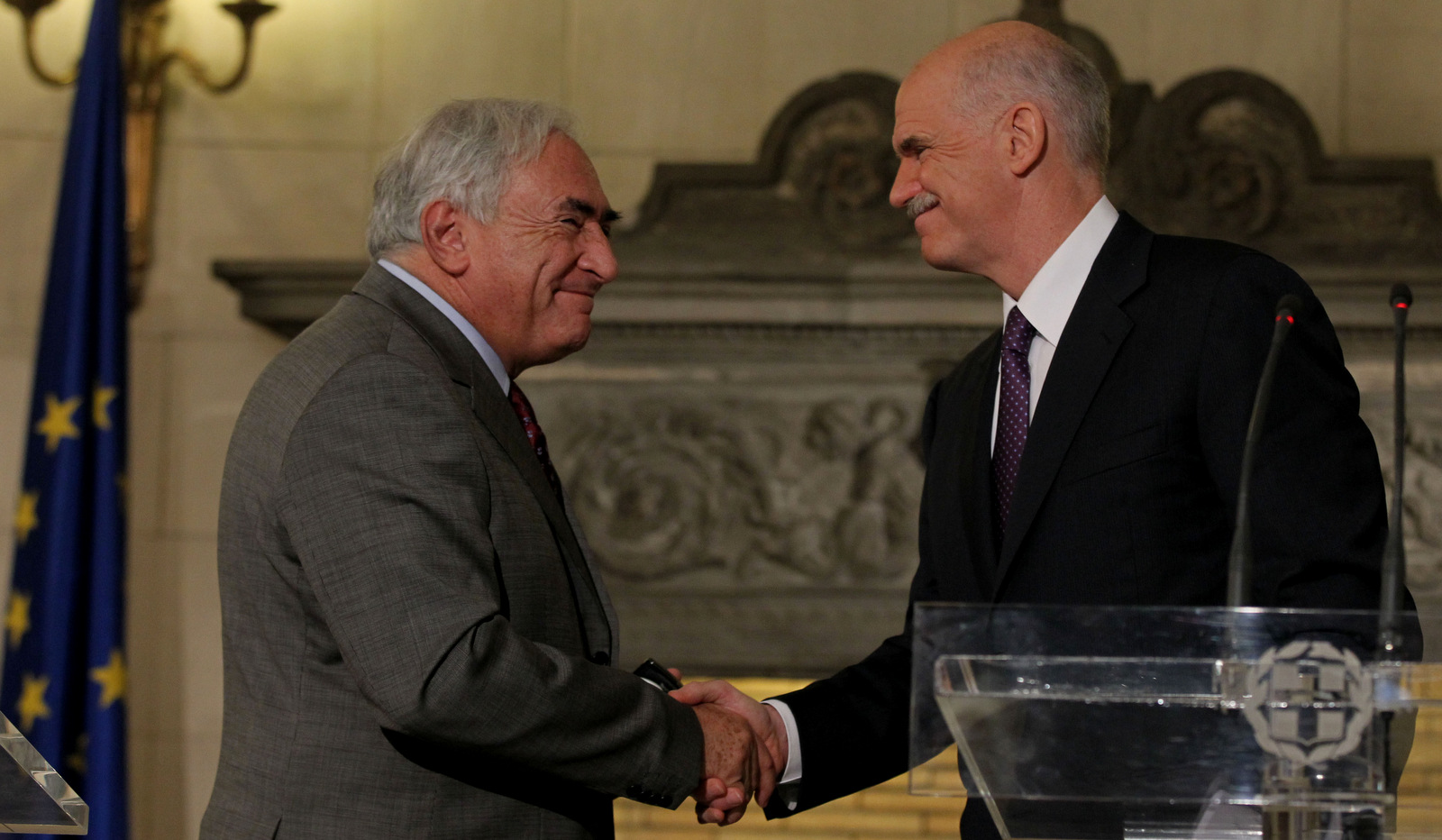 Greek Prime Minister George Papandreou, right, shakes hand with the head of the International Monetary Fund, Dominique Strauss-Kahn, during a joint news conference in Athens, Dec. 7, 2010. (AP/Thanassis Stavrakis)