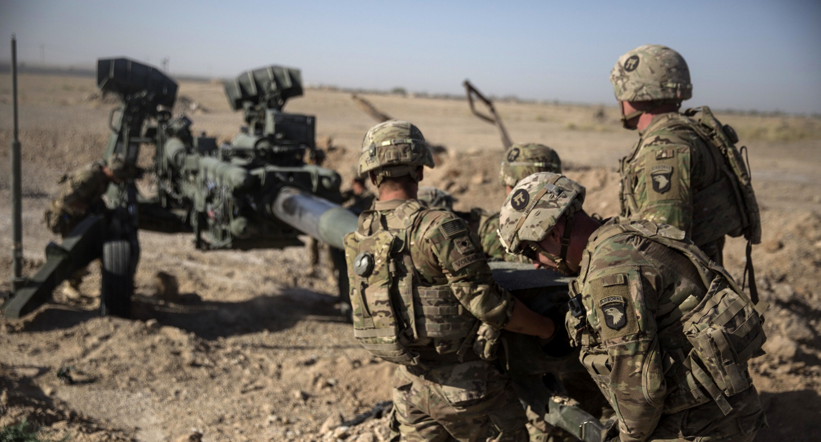 "U.S. Soldiers with Task Force Iron maneuver an M-777 howitzer, so it can be towed into position at Bost Airfield, Afghanistan. Reversing his past calls for a speedy exit, U.S. President Donald Trump recommitted the United States to the 16-year-old war in Afghanistan, declaring U.S. troops must ""fight to win."" He pointedly declined to disclose how many more troops will be dispatched to wage America's longest war. (U.S. Marine Corps photo by Sgt. Justin T. Updegraff, Operation Resolute Support via AP)"