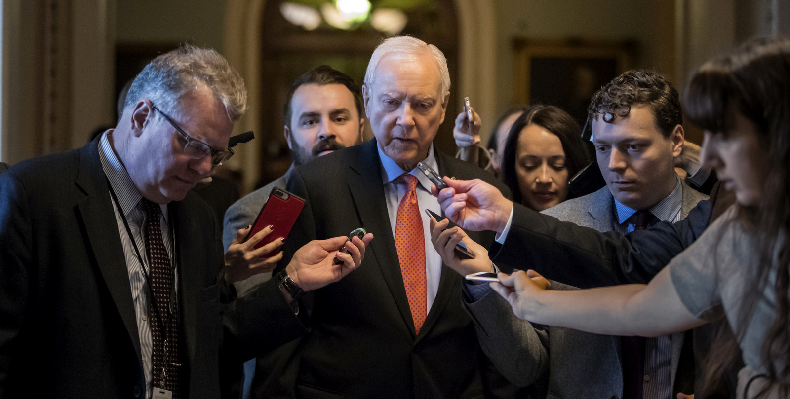 Reporters ask questions of Sen. Orrin Hatch, R-Utah, chairman of the tax-writing Finance Committee, as he walks to meet with Senate Majority Leader Mitch McConnell, R-Ky., on the GOP effort to overhaul the tax code, on Capitol Hill in Washington, Dec. 1, 2017. (AP/J. Scott Applewhite)