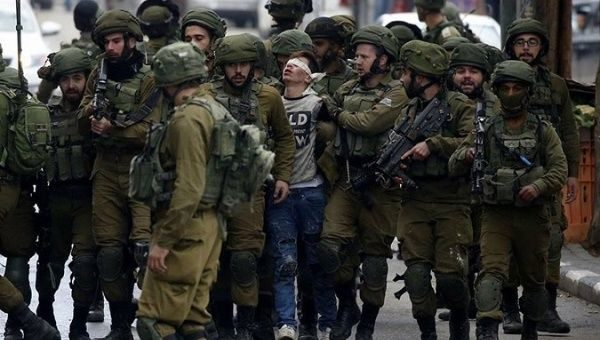 'They Stepped on Me': Palestinian Teen in Viral Photo Released on Bail