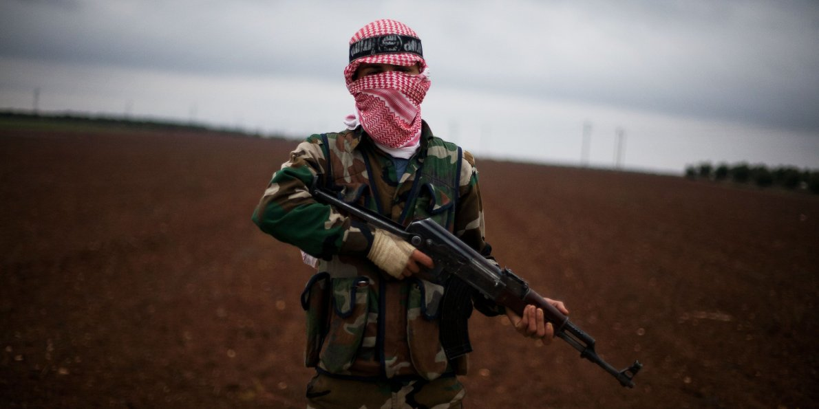 A Free Syrian Army fighter takes position close to a Syrian military base near Azaz, Syria, Dec. 10, 2012. (AP/Manu Brabo)