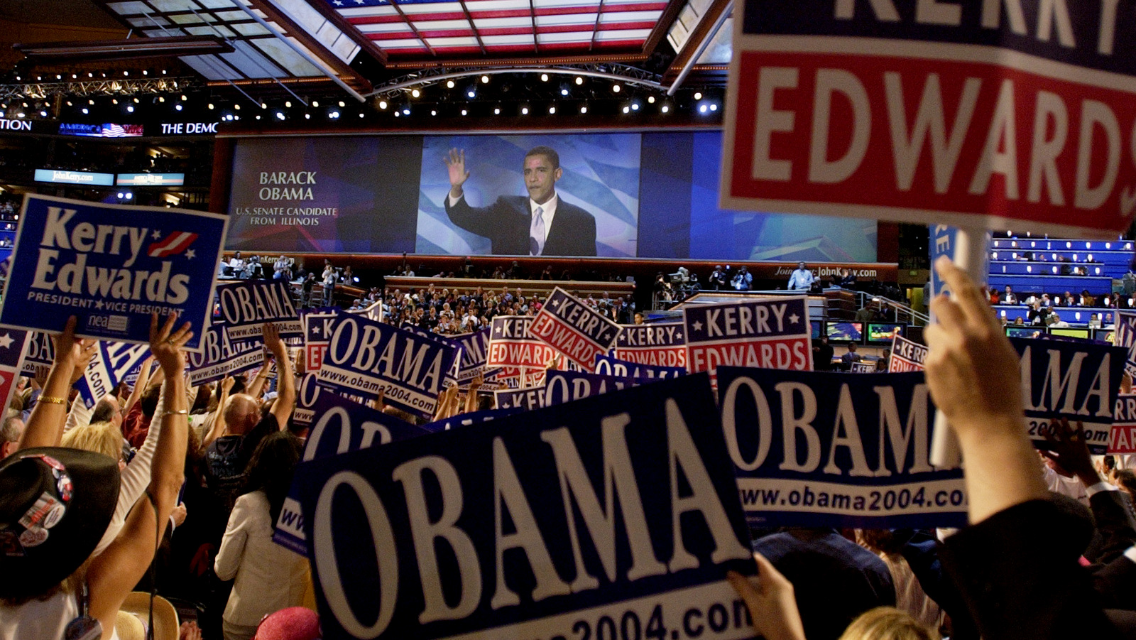 Delegates cheer as keynote speaker Barack Obama, candidate for the Senate from Illinois, speaks during the Democratic National Convention at the FleetCenter in Boston, July 27, 2004. (AP/Laura Rauch)