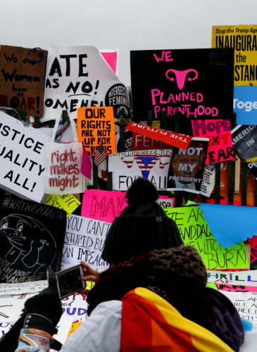 Protesters build a wall of signs outside the White House for the Women's March on Washington during the first full day of Donald Trump's presidency in Washington, Jan. 21, 2017. (AP/John Minchillo)