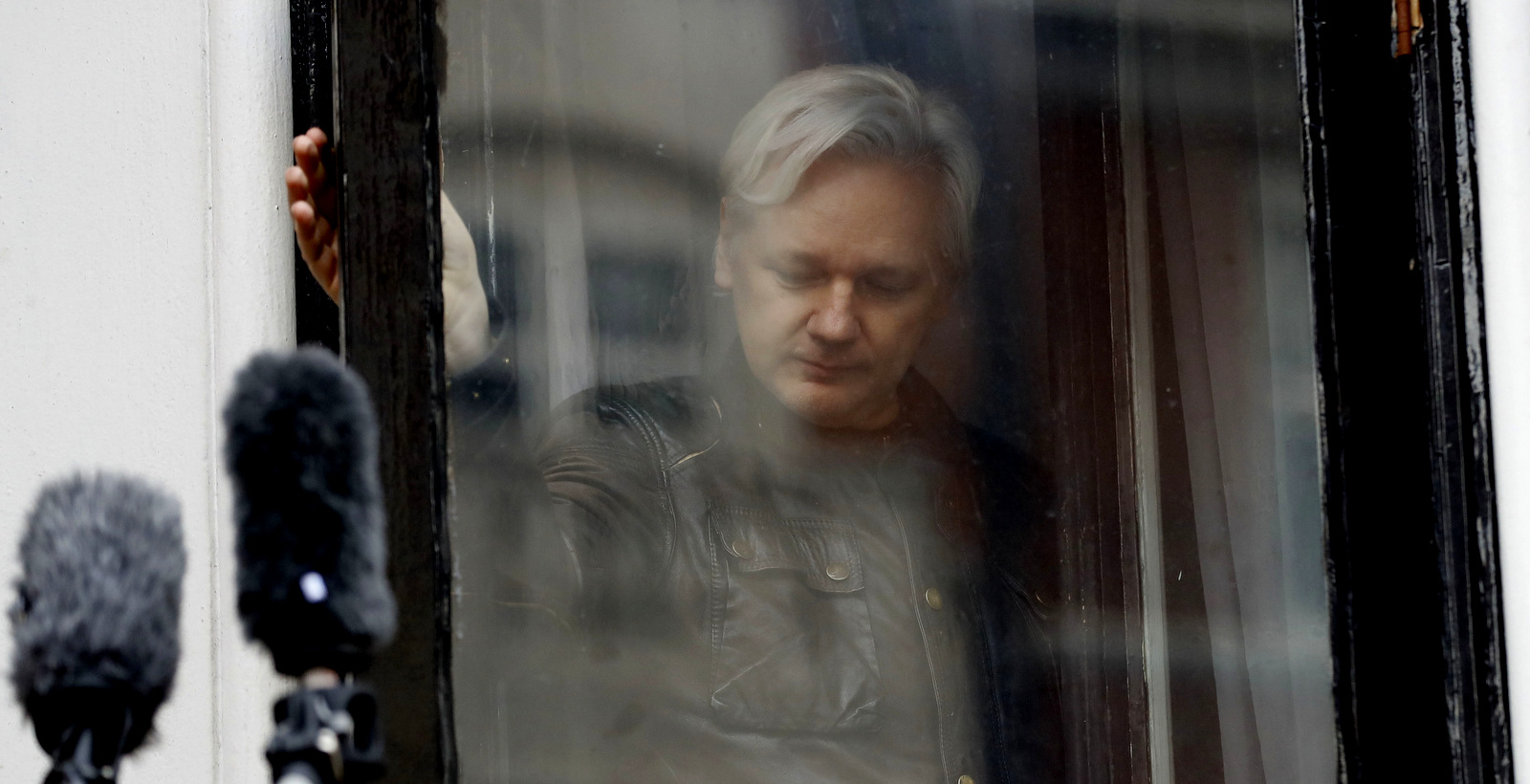 WikiLeaks founder Julian Assange leaves after greeting supporters outside the Ecuadorian embassy in London, May 19, 2017 (AP/Frank Augstein)