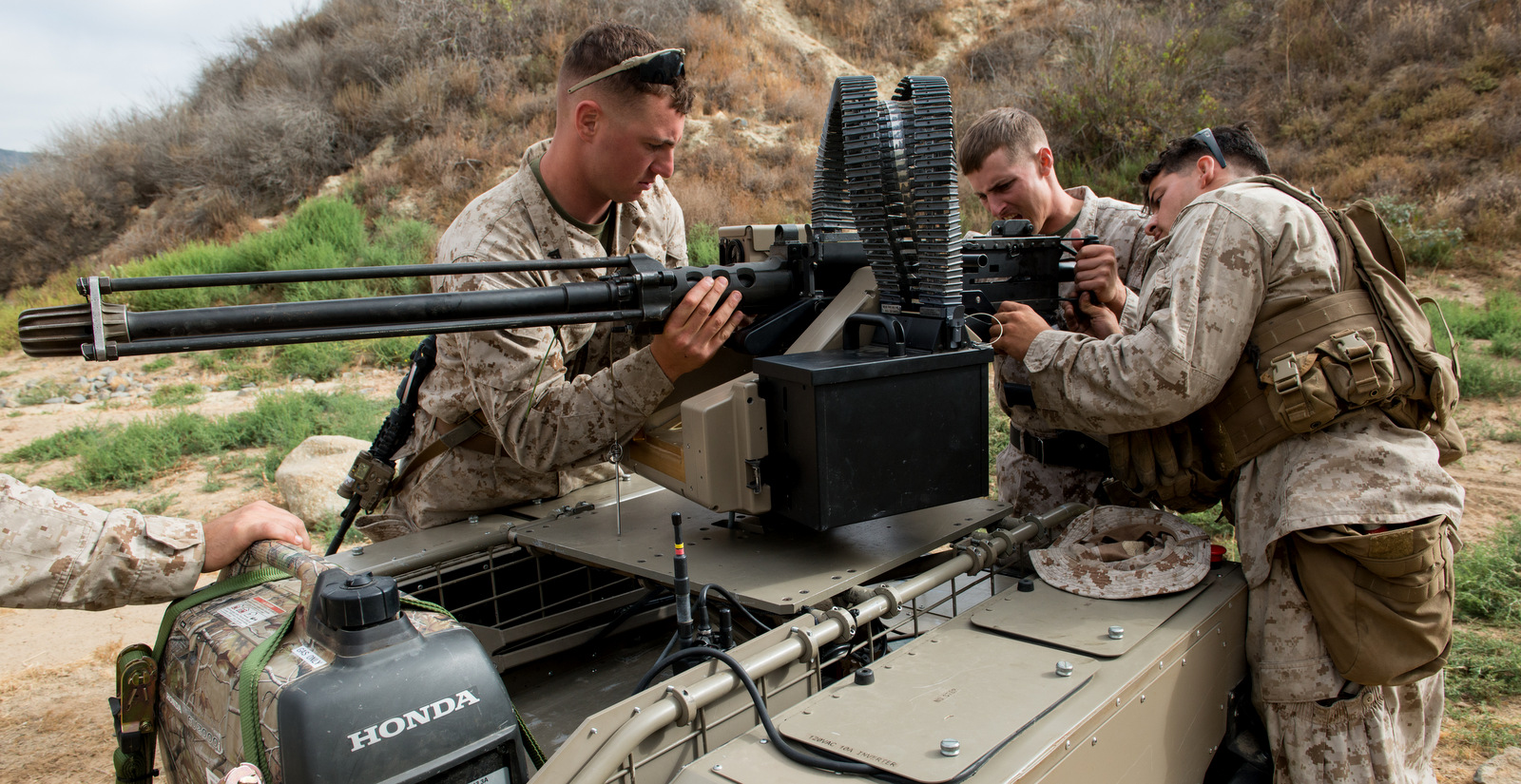 U.S. Marines adjust a mounted gun on the Multi Utility Tactical Transport (MUTT) for testing at Marine Corps Base Camp Pendleton, Calif., July 8, 2016. (U.S. Marine Corps photo)