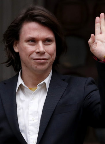 Lauri Love waves to supporters outside The Royal Courts of Justice in London, Monday, Feb. 5, 2018. The ruling in Lauri Love's appeal against extradition to the United States, where he faces solitary confinement and a potential 99 year prison sentence, will be handed down on Monday Feb. 5 at the Royal Courts of Justice. (AP Photo/Kirsty Wigglesworth)