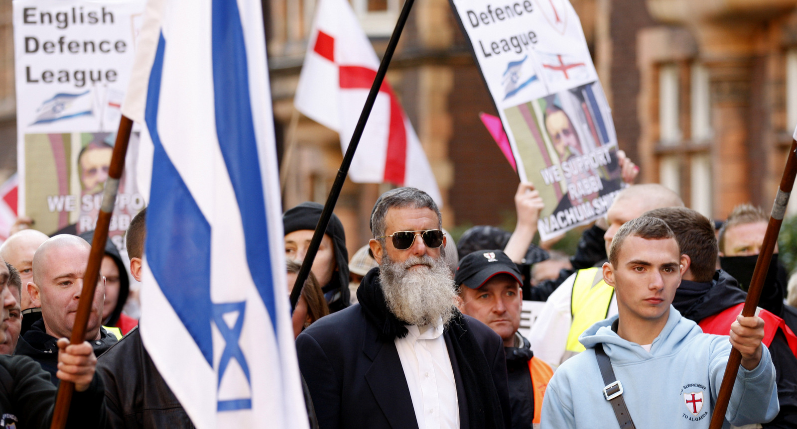 Rabbi Nachum Shifren, center, marches with white nationalist English Defence League (EDL) supporters to an EDL rally against what they claim is the Islamification of the UK and in support of Israel, outside the Israeli Embassy in London, Oct. 24, 2010. (AP/Sang Tan)