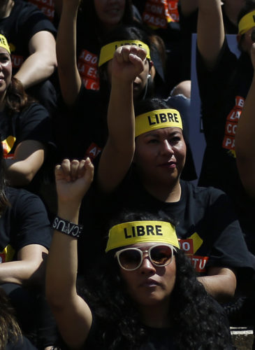 People protesting against human trafficking and slavery raise their fists during a demonstration in Mexico City, Oct. 14, 2017. (AP/Marco Ugarte)