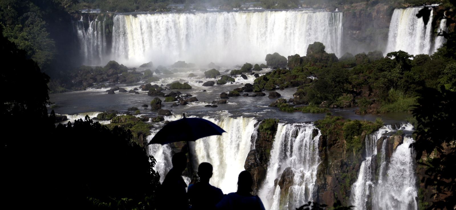 Tourists visit Iguazu Falls in Brazil. The falls are part of the world's largest reservoir of fresh water, known as the Guarani Aquifer. They are in the middle of thick jungle that has more than 1,000 plant and hundreds of animal species., March 15, 2015.(AP/Jorge Saenz)