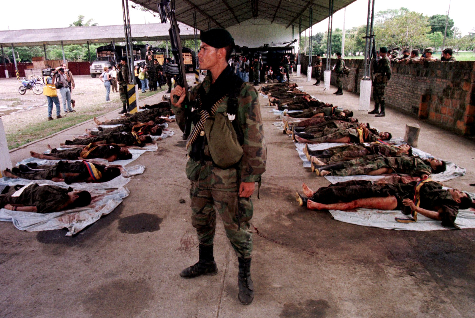 Colombian soldiers display the bodies of 30 Revolutionary Armed Forces of Colombia, or FARC, rebels to the prress in Granada, about 180 kilometers (112 miles) outside of Bogota, Colombia, Monday, July 12, 1999. (AP/Scott Dalton)