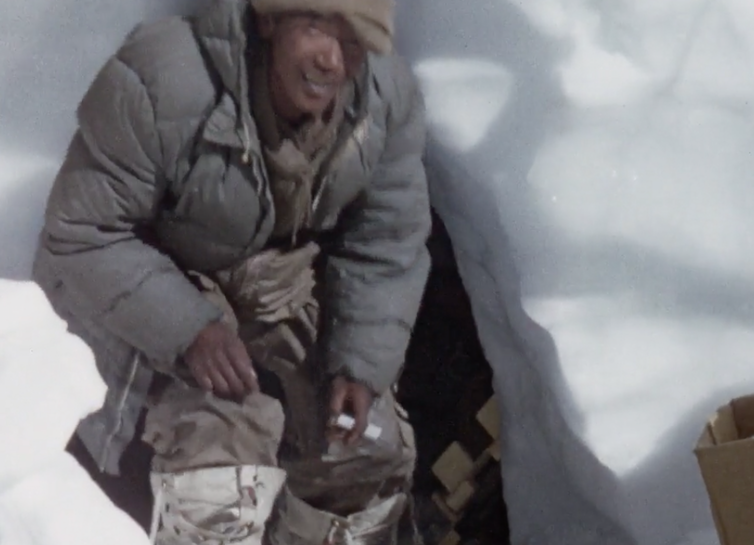At home in a snow hole. Still from Kangchenjunga 1955. British Film Institute/Royal Geographical Society