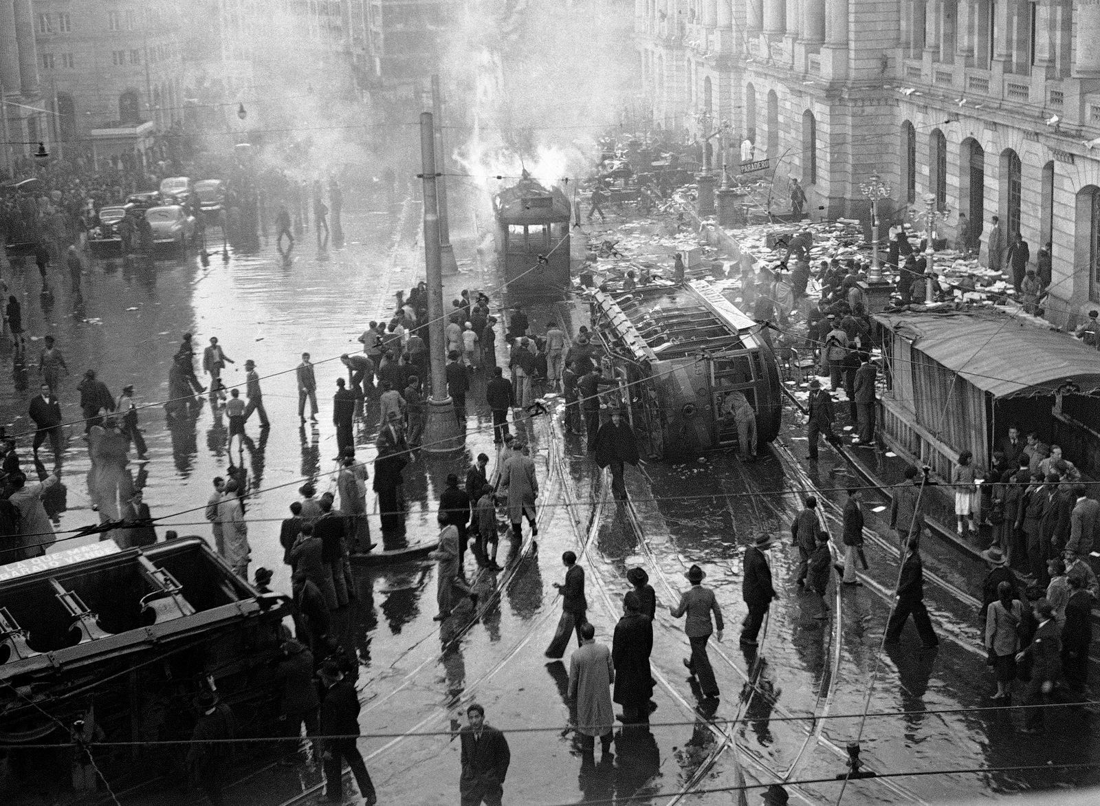 "A street car is overturned and burned during an uprising following the assassination of Jorge Eliecer Gaitan in Bogota, Columbia. The 1948 assassination of Gaitan sparked the political bloodletting known as ""La Violencia,"" or ""The Violence."" (AP/E. L. Almen)"