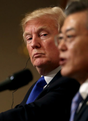 "President Donald Trump, left, listens to South Korean President Moon Jae-in during a joint news conference at the Blue House in Seoul, South Korea, Nov. 7, 2017. President Donald Trump, on his first day on the Korean peninsula, signaled a willingness to negotiate with North Korea to end its nuclear weapons program, urging Pyongyang to ""come to the table"" and ""make a deal."" (AP/Andrew Harnik)"