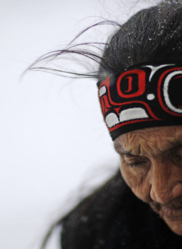 """Grandma Redfeather of the Sioux walks in the snow to get water at the Oceti Sakowin camp where people have gathered to protest the Dakota Access oil pipeline in Cannon Ball, N.D. """"It's for my people to live and so that the next seven generations can live also,"""" said Redfeather of why she came to the camp. """"I think about my grandchildren and what it will be like for them."""" Nov. 29, 2016. (AP/David Goldman)"""
