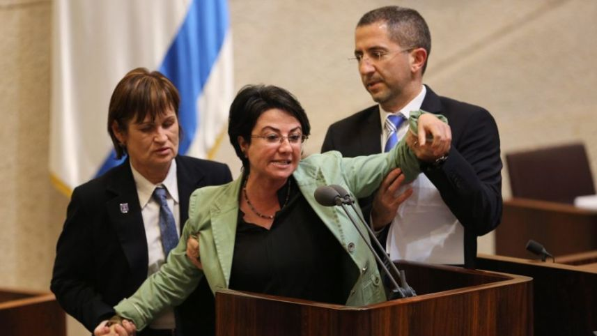 Haneen Zoabi being removed from the Knesset podium in February 2016. (Photo: Emil Salman)