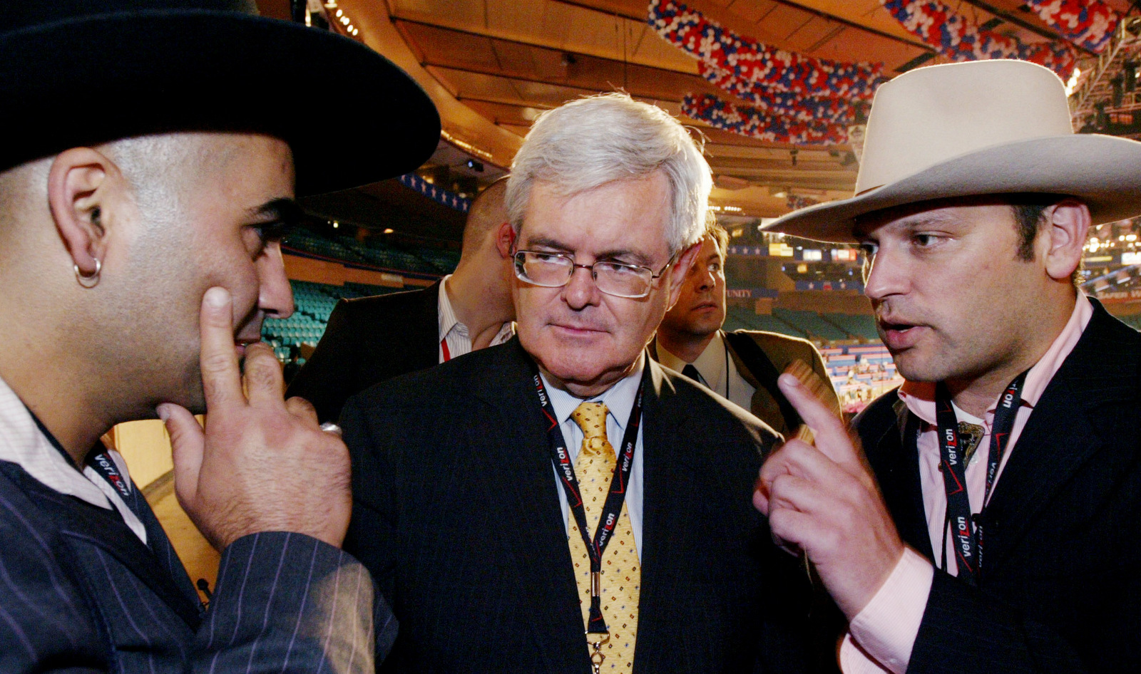 Newt Gingrich, center, former Speaker of the U. S. House of Representatives, is interviewed by Dutch television journalists Gideon Levy, left, and Bahram Sadeghi at the Republican National Convention in Madison Square Garden, Sept. 1, 2004 in New York. (AP/Gregory Bull)