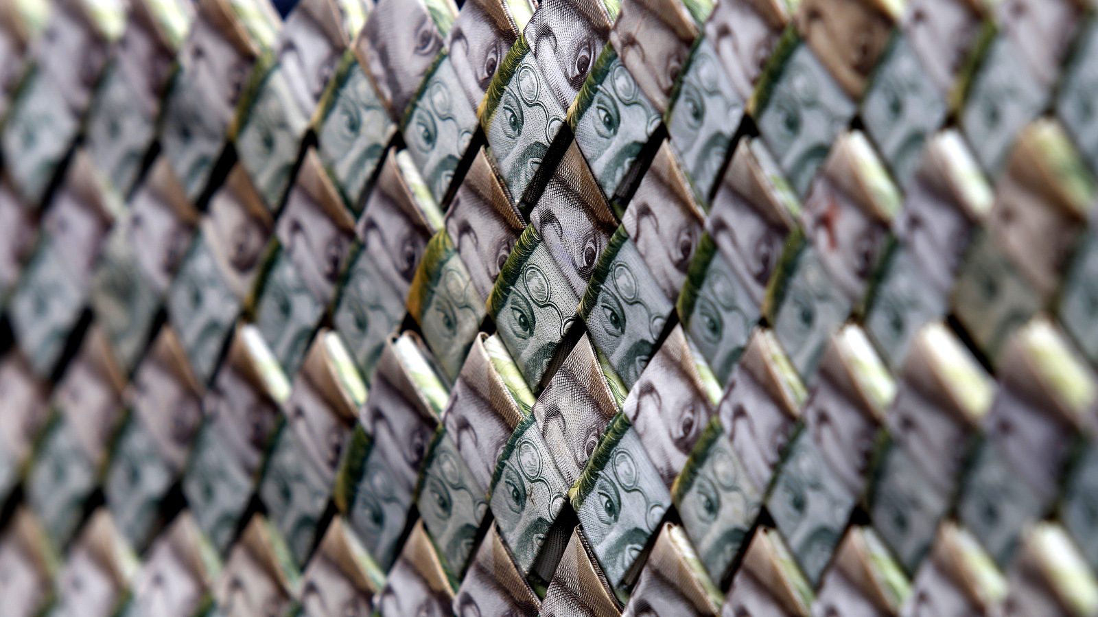 Venezuelan Bolivars weaved together create a purse that is for sale in La Parada, Colombia, on the border with Venezuela, Feb. 22, 2018. (AP/Fernando Vergara)