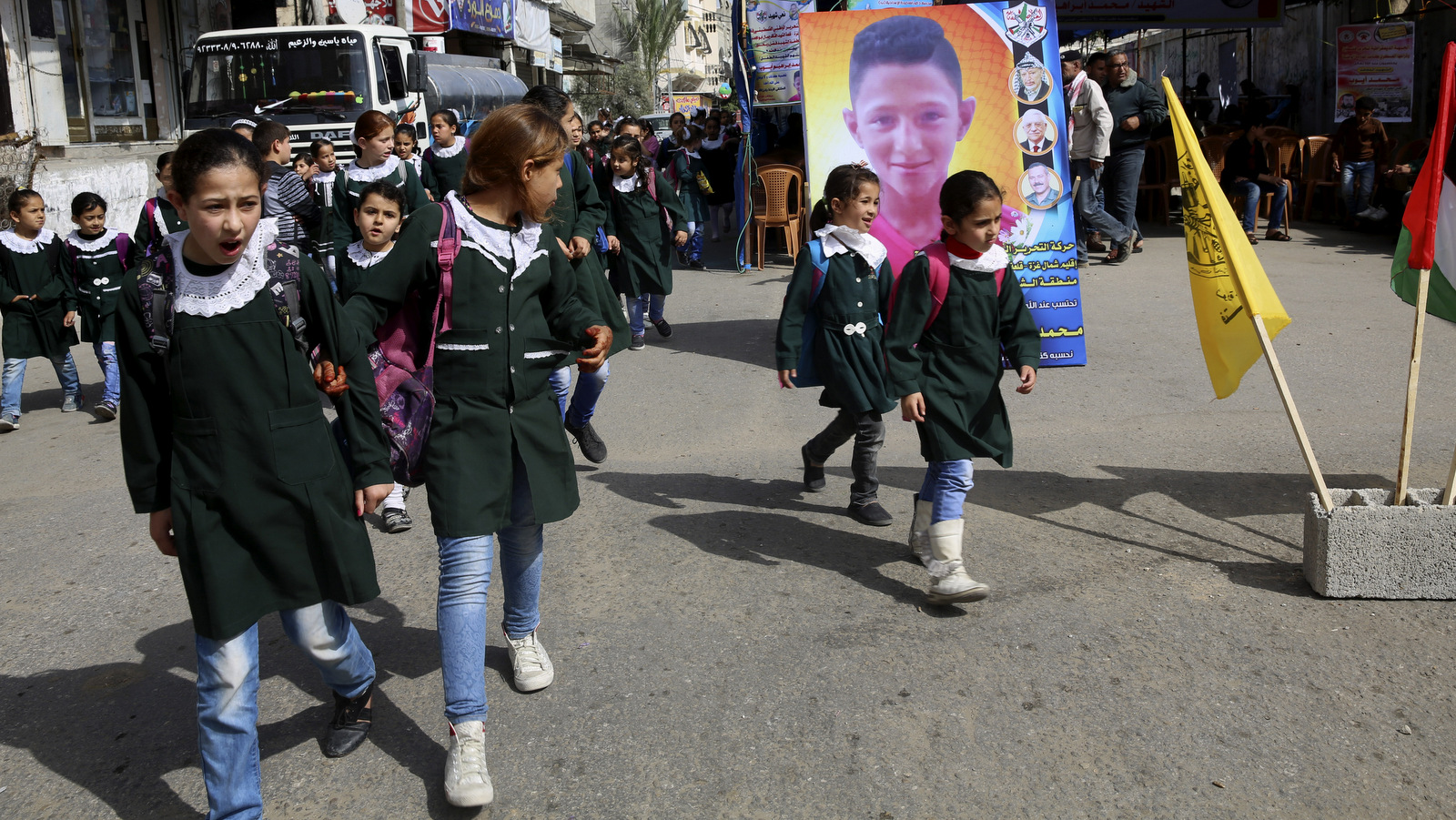 School girls look while pass the house morning of Mohammed Ayyoub, 14, who was killed by Israeli soldiers during a protest on Gaza's border with Israel, east of Jebaliya,, April 21, 2018. (AP/Adel Hana)