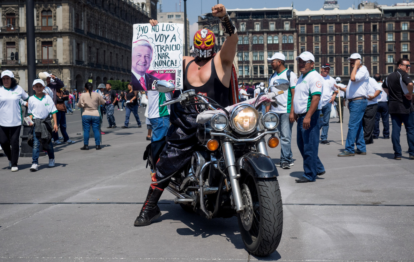 A supporter of the Mexican Union of Electrical Workers in his disguise as a luchador wrestler holds a sign showing support for leftist presidential candidate Andres Manuel Lopez Obrador in the Zocalo of Mexico City, May 1, 2018. (Photo: José Luis Granados Ceja)