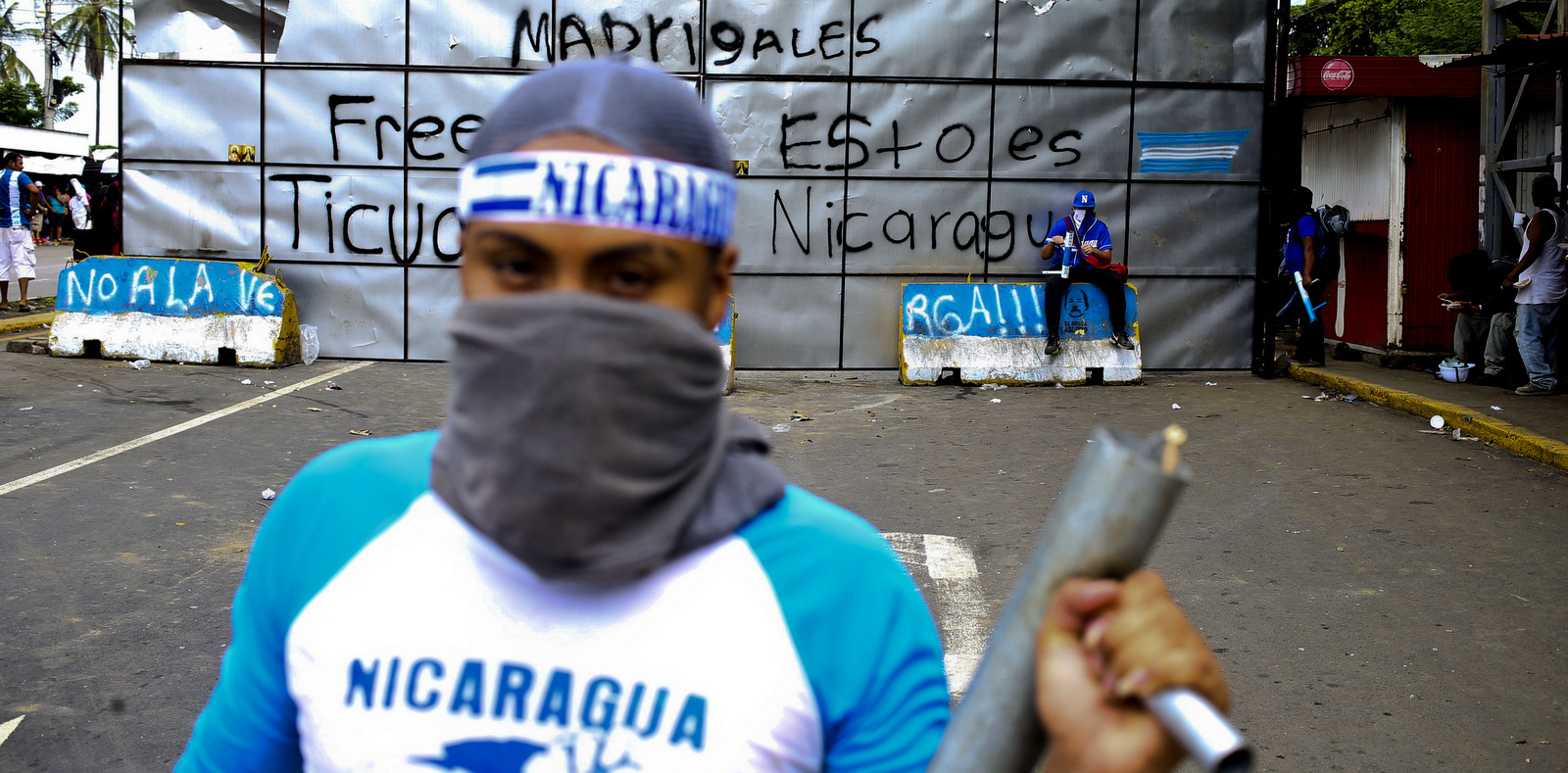 An anti-government protester poses for a picture holding a homemade mortar at a roadblock set up by protesters in Ticuantepe, Nicaragua, June 6, 2018. Esteban Felix | AP
