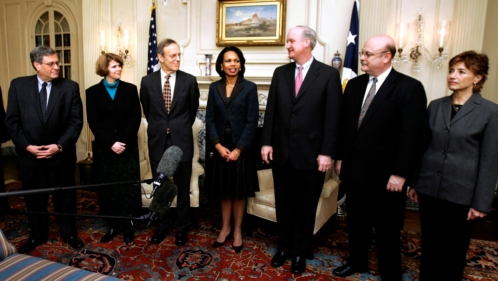 Condoleezza Rice, fourth from left, accompanied by participants from Non-governmental organizations, speaks to reporters at the State Department in Washington, Wednesday, Jan. 31, 2007. From left are, Ken Wollack, National Democratic Institute; Jennifer Windsor, Freedom House; Carl Gershman, National Endowment for Democracy; Rice; Lorne Craner, International Republican Institute; John Sullivan, Center for International Private Enterprise; and Ellie Larson, Solidarity Center. Manuel Balce Ceneta | AP