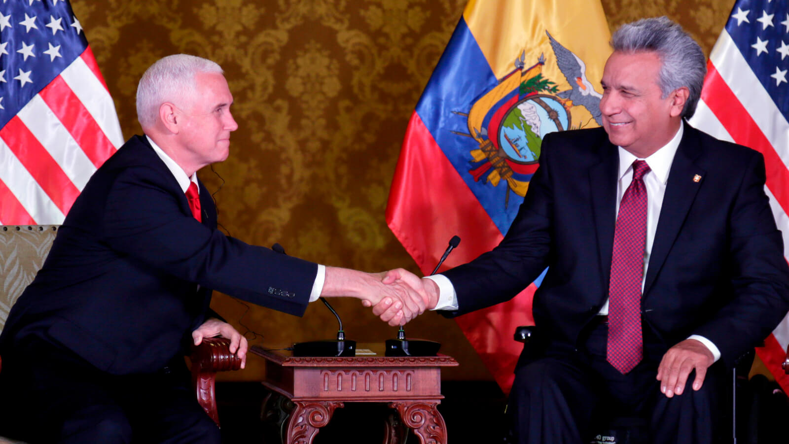 Ecuador's President Lenin Moreno, right, shakes hand with U.S. Vice President Mike Pence at the government palace in Quito, Ecuador, June 28, 2018. Dolores Ochoa | AP