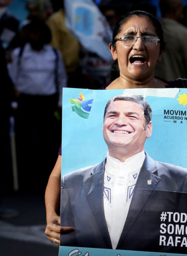 Supporters of former President Rafael Correa participate in a rally in his favor after a judge ordered him jailed for failing to appear in court as required as part of a kidnapping probe, in Quito, Ecuador, Thursday, July 5, 2018. (AP Photo/Dolores Ochoa)