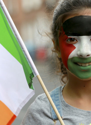 Mona Abdul Magid (9), holds an Irish flag outside Leinster House on July 11, 2018, in Dublin. Palestinian farmers handed over a symbolic olive tree to show support for the Occupied Territories Bil. Crispin Rodwell | AP