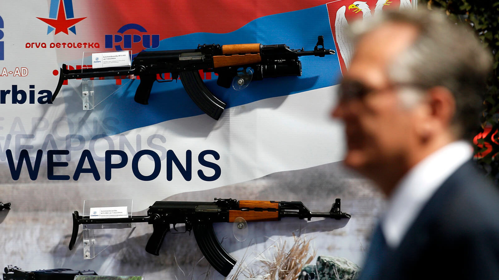 In this June 28, 2011 file photo, a visitor looks at assault rifles made by the Serbian company Zastava Arms, during a defense fair, in Belgrade, Serbia. Darko Vojinovic | AP