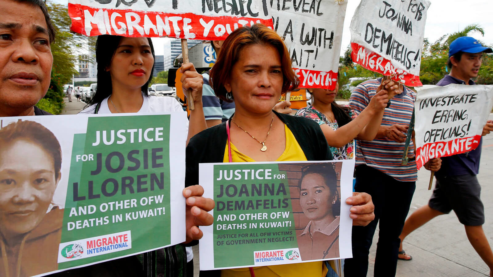Protesters picket the Senate at the start of the probe in the death of an overseas worker in Kuwait, Pasay city south of Manila, Philippines