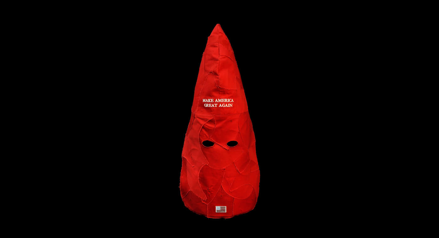 Facebook Bans Political Artist for Provocative MAGA-Hats-as-Klan-Hoods Sculpture