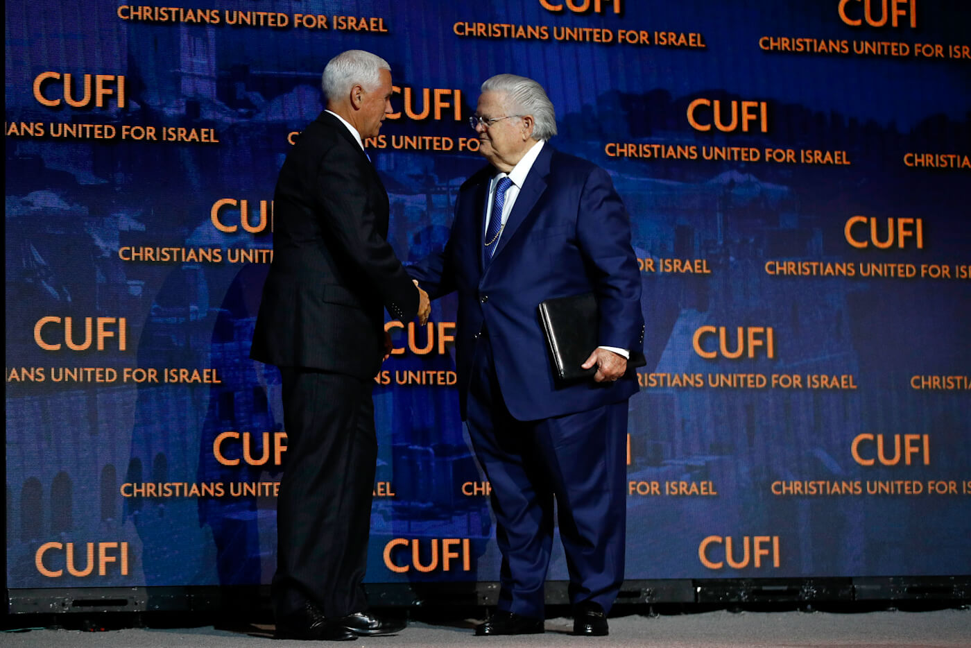 Vice President Pence, left, greets Hagee at CUFI's annual summit, July 8, 2019, in Washington. Patrick Semansky | AP