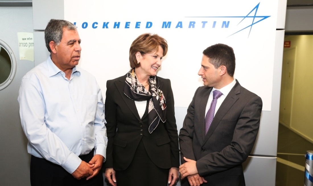 Marillyn Hewson, center, poses with Israeli gov. officials at the opening of Lockheed Martin's facility in Beersheba. Photo | Diego Mittleberg